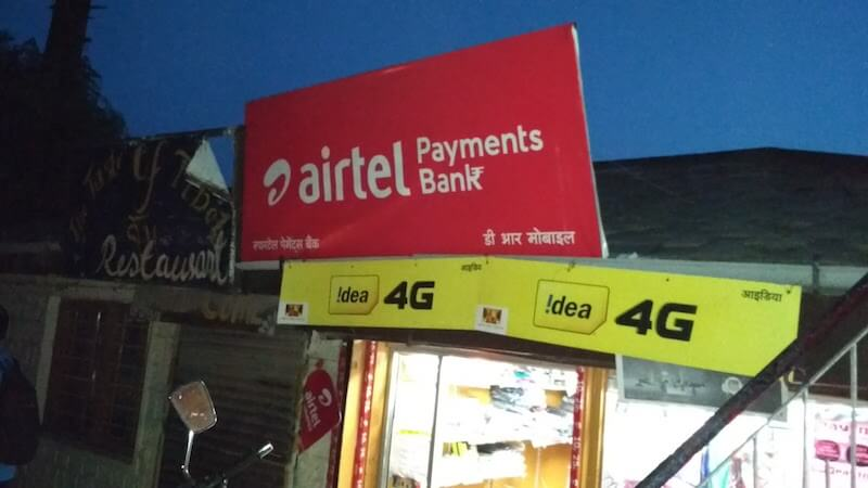 Photo showing an Airtel board atop a shop