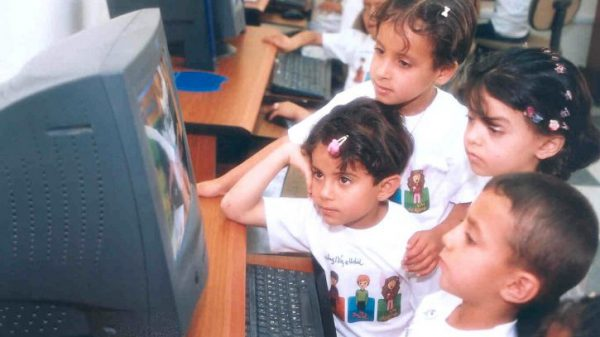 Young children looking a computer screen