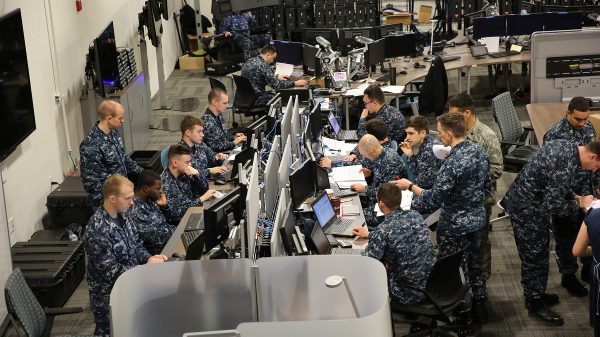 Photo of sailors working together at a joint cyber training center during an April 2017 exercise.
