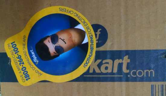 A Flipkart delivery box with a Flipkart sticker