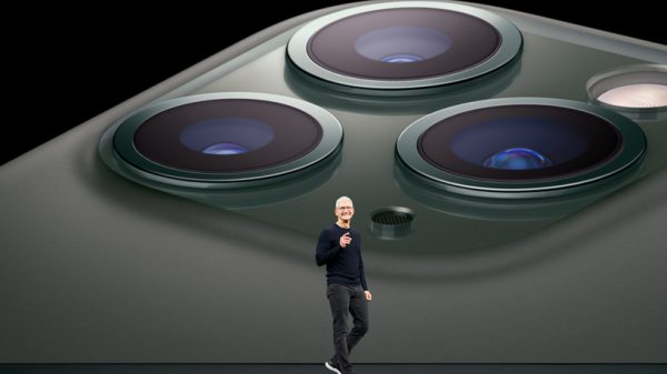 Photo of iPhone 11 Pro camera with Tim Cook in the background